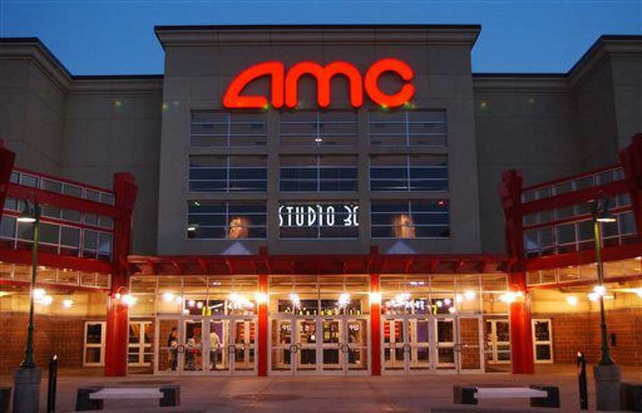 FILE - In this May 11,2005 file photo, people enter AMC's Studio 30 theater in Olathe, Kan. AMC Theatres is buying European movie theater operator Odeon & UCI Cinemas Group in a deal valued at about 921 million pounds ($1.21 billion). AMC says, Tuesday, July 12, 2016, that the transaction will make it the biggest movie theater operator in the world. Odeon & UCI has 242 theaters in Europe. The deal will give AMC a total of 627 theaters in eight countries. (AP Photo/Orlin Wagner) Photo: ORLIN WAGNER