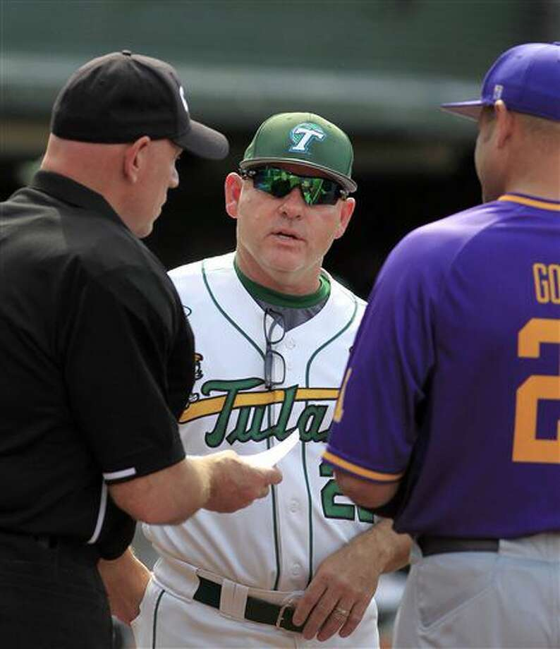 In this April 9, 2016 photo, Tulane NCAA college baseball coach David Pierce, center, talks with an umpire and East Carolina head coach Cliff Godwin prior to the game game at Turchin Stadium in New Orleans. Texas reached an agreement Wednesday, June 29, 2016, with Tulane baseball coach David Pierce to take over the Longhorns' program, a person with knowledge of the decision said. (A.J. Sisco/The Advocate via AP) MAGS OUT; INTERNET OUT; NO SALES; TV OUT; NO FORNS; LOUISIANA BUSINESS INC. OUT (INCLUDING GREATER BATON ROUGE BUSINESS REPORT, 225, 10/12, INREGISTER, LBI CUSTOM); MANDATORY CREDIT Photo: A.J. Sisco