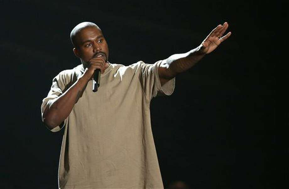 FILE - In this Aug. 30, 2015, file photo, Kanye West accepts the video vanguard award at the MTV Video Music Awards at the Microsoft Theater in Los Angeles. West and Adidas are expanding their partnership that began almost two years ago with retail hubs for his Yeezy products and additional sportswear designs. The sportswear company announced the collaboration on Wednesday, June 29, 2016, and described it as the most significant partnership between a non-athlete and an athletic brand. (Photo by Matt Sayles/Invision/AP, File) Photo: Matt Sayles