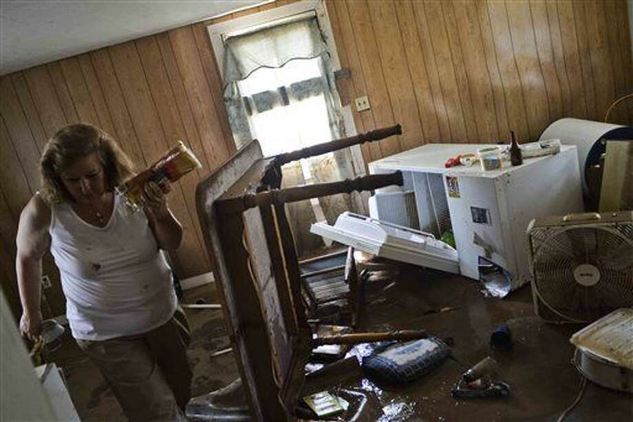Theresa Havers helps clean out the kitchen of her son's home after flooding in Rainelle, W.Va., Sunday, June 26, 2016. (Christian Tyler Randolph/Charleston Gazette-Mail via AP) MANDATORY CREDIT Photo: Christian Tyler Randolph