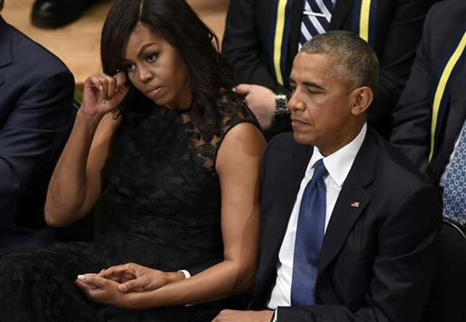 President Barack Obama and first lady Michelle Obama attend an interfaith memorial service for the fallen police officers and members of the Dallas community at the Morton H. Meyerson Symphony Center in Dallas, Tuesday, July 12, 2016. (AP Photo/Susan Walsh)