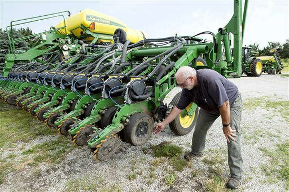 Farmer Mick Minchow takes a look at the fine components of his John Deere planter on Monday, June 20, 2016, at his farm in Waverly, Neb. (Kristin Streff/Lincoln Journal Star via AP) Photo: Kristin Streff
