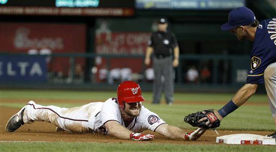 Washington Nationals' Daniel Murphy (20) is tagged out at third base by Milwaukee Brewers third baseman Will Middlebrooks trying to stretch a double into a triple, during the eighth inning of a baseball game at Nationals Park, Tuesday, July 5, 2016, in Washington. The Brewers won 5-2. (AP Photo/Alex Brandon) Photo: Alex Brandon
