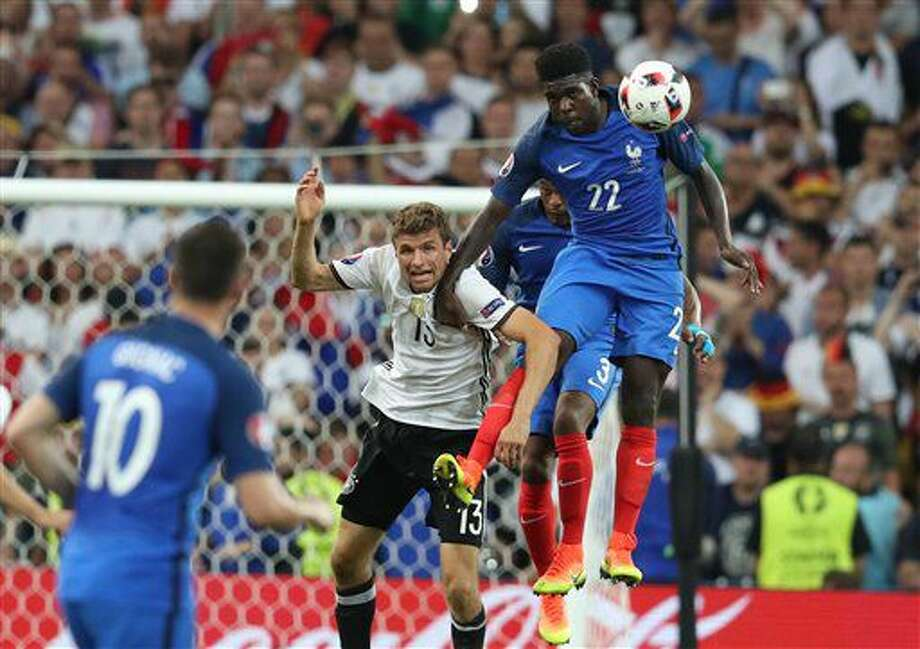 France's Samuel Umtiti, right, jumps for a header with Germany's Thomas Mueller during the Euro 2016 semifinal soccer match between Germany and France, at the Velodrome stadium in Marseille, France, Thursday, July 7, 2016. (AP Photo/Thanassis Stavrakis) Photo: Thanassis Stavrakis