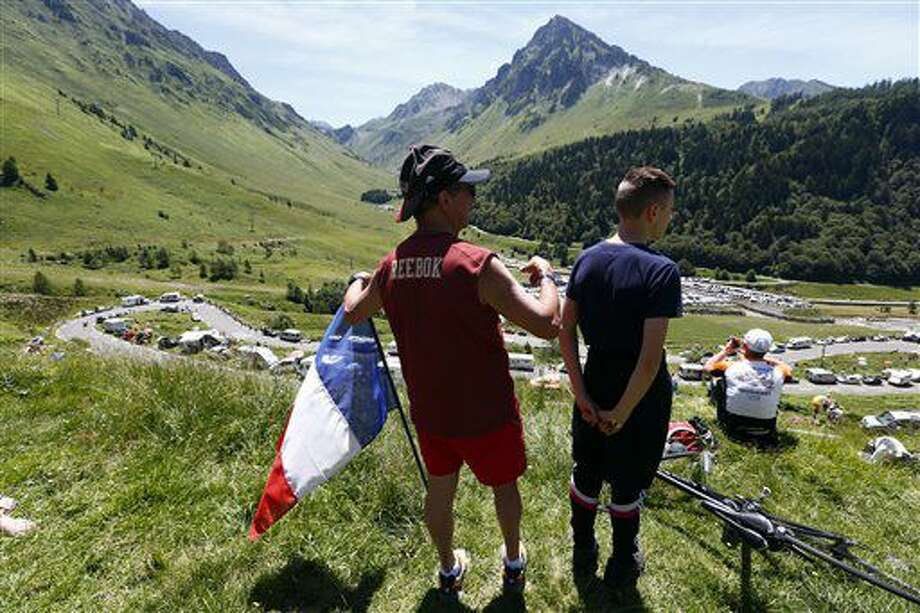 Spectators watch the riders during the eighth stage of the Tour de France cycling race over 184 kilometers (114.3 miles) with start in Pau and finish in Bagneres-de-Luchon, France, Saturday, July 9, 2016. (AP Photo/Peter Dejong) Photo: Peter Dejong