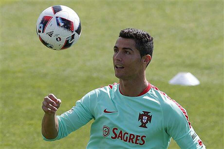 Portugal's Cristiano Ronaldo controls the ball during a training session, in preparation of the Euro 2016 final soccer match between France and Portugal, at Marcoussis, south of Paris, France, Friday, July 8, 2016. (AP Photo/Francois Mori) Photo: Francois Mori
