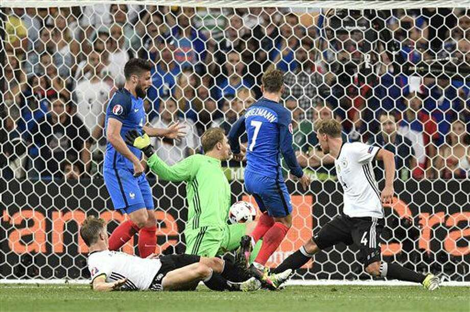 France's Antoine Griezmann, center, scores his side's second goal during the Euro 2016 semifinal soccer match between Germany and France, at the Velodrome stadium in Marseille, France, Thursday, July 7, 2016. (AP Photo/Martin Meissner) Photo: Martin Meissner