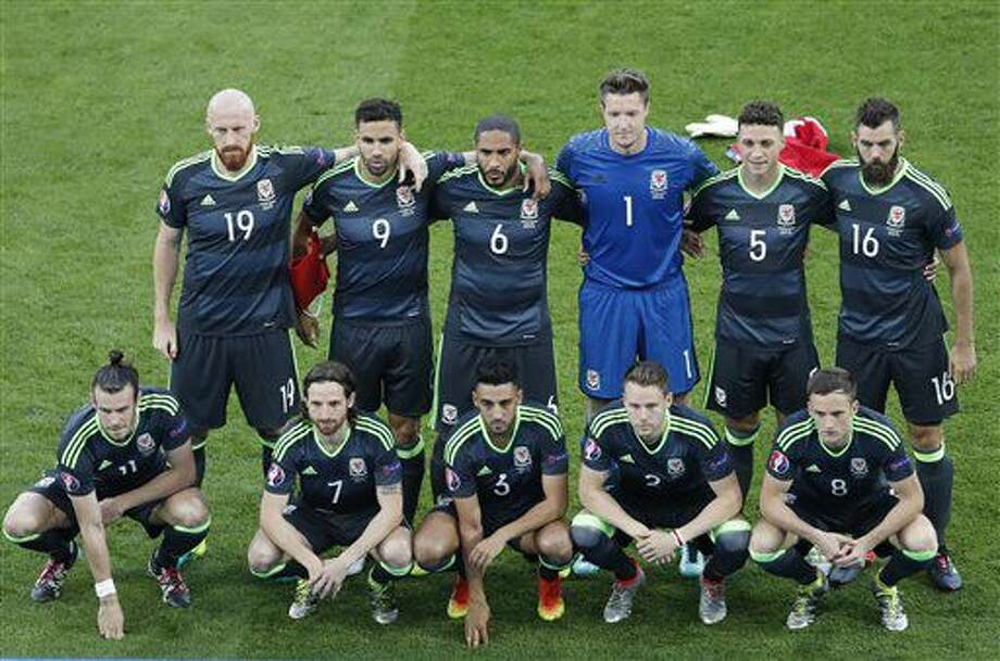 The Welsh team line up for a team group photo prior to the Euro 2016 semifinal soccer match between Portugal and Wales, at the Grand Stade in Decines-Charpieu, near Lyon, France, Wednesday, July 6, 2016. (AP Photo/Michael Sohn) Photo: Michael Sohn