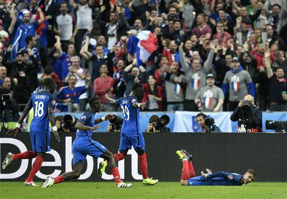 France's Antoine Griezmann, on the ground, celebrates after scoring his side's fourth goal during the Euro 2016 quarterfinal soccer match between France and Iceland, at the Stade de France in Saint-Denis, north of Paris, France, Sunday, July 3, 2016. (AP Photo/Martin Meissner) Photo: Martin Meissner