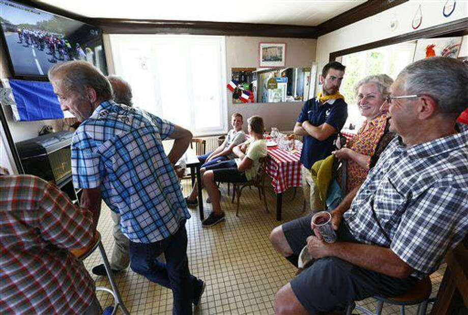People watch the sixth stage of the Tour de France cycling race in a bar, a stage over 190.5 kilometers (118.1 miles) with start in Arpajon-sur-Cere and finish in Montauban, France, Thursday, July 7, 2016. (AP Photo/Peter Dejong) Photo: Peter Dejong