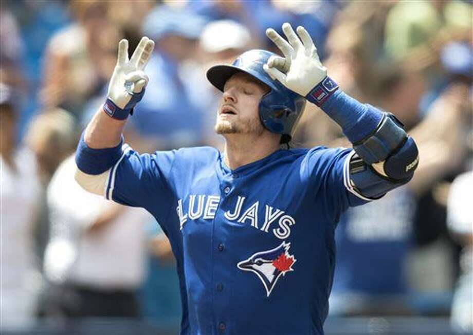Toronto Blue Jays' Josh Donaldson crosses home plate after hitting a three-run home run against the Detroit Tigers in the fourth inning of their American League MLB baseball game in Toronto on Sunday, July 10, 2016. (Fred Thornhill/The Canadian Press via AP) Photo: Fred Thornhill