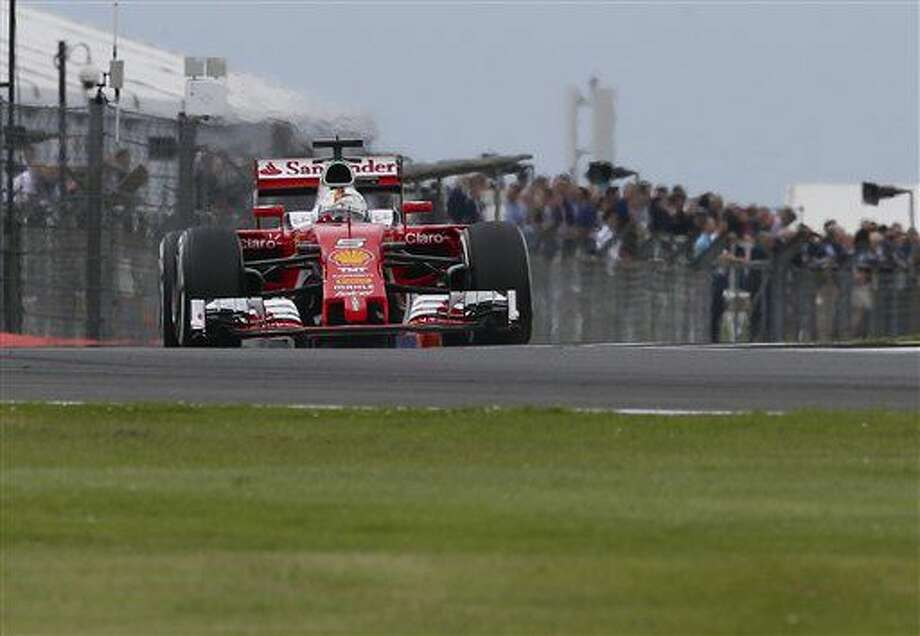 Ferrari driver Sebastian Vettel of Germany steers his car during the third free practice at the Silverstone racetrack, Silverstone, England, Saturday, July 9, 2016. The British Formula One Grand Prix will be held on Sunday July 10. (AP Photo/Luca Bruno) Photo: Luca Bruno