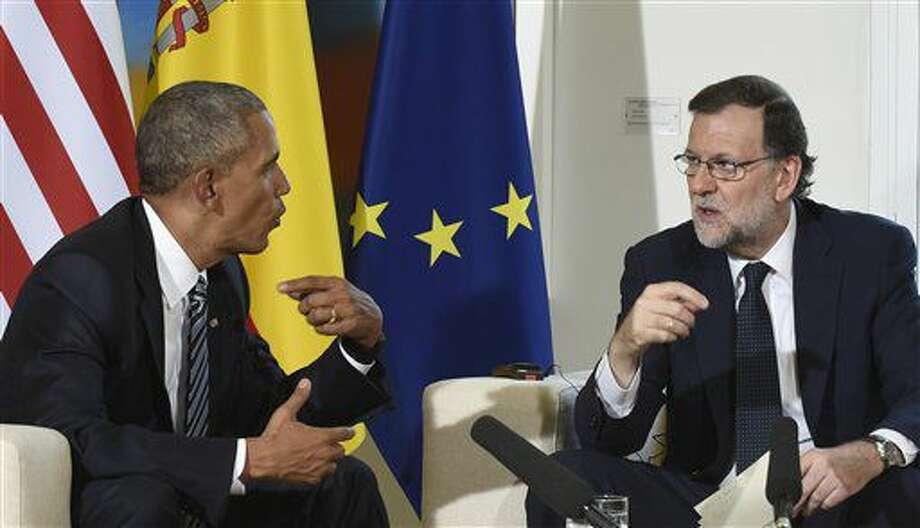 El presidente de Estados Unidos, Barack Obama, a la izquierda, conversa con el presidente interino del gobierno español Mariano Rajoy en el Palacio de La Moncloa en Madrid, España, el domingo 10 de julio de 2016. (AP Foto/Susan Walsh) Photo: Susan Walsh