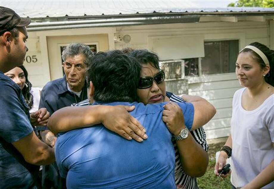 Mary Lisa Selgado, right, hugs crisis counselor Teresa Gonzalez, of Texans Recovering Together, Monday July 11, 2016, at her home on River Road in San Marcos, Texas, after talking about the 2015 flood which destroyed her home and belongings. Her father, Senon Selgado Jr., left, has lived in the house for decades. (Jay Janner/Austin American-Statesman via AP) Photo: Jay Janner
