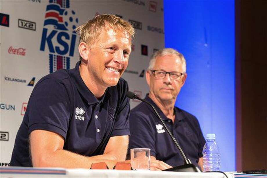 Iceland joint-coaches Heimir Hallgrimsson, left, and Lars Lagerback speak to the media at their European Championship tournament base in Annecy, French Alps, Wednesday June 29, 2016. Iceland has become the darling of the European Championship thanks to its underdog status and an uncompromising 4-4-2 formation that has made the team unbeatable so far in France. (AP Photo/Ciaran Fahey) Photo: Ciaran Fahey