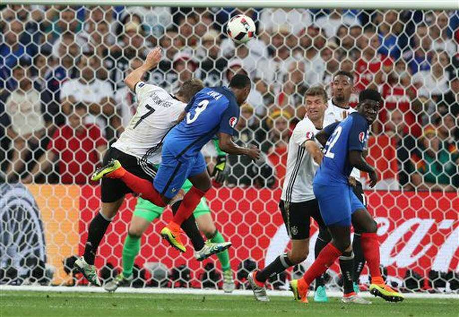 Germany's Bastian Schweinsteiger, left, jumps for a header with France's Patrice Evra during the Euro 2016 semifinal soccer match between Germany and France, at the Velodrome stadium in Marseille, France, Thursday, July 7, 2016. (AP Photo/Thanassis Stavrakis) Photo: Thanassis Stavrakis