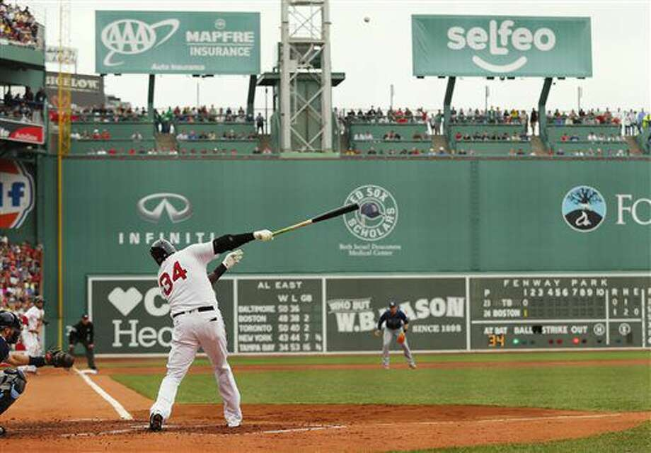 Boston Red Sox designated hitter David Ortiz hits an opposite field two-run home run against the Tampa Bay Rays during the first inning of a baseball game at Fenway Park in Boston Sunday, July 10, 2016. (AP Photo/Winslow Townson) Photo: Winslow Townson