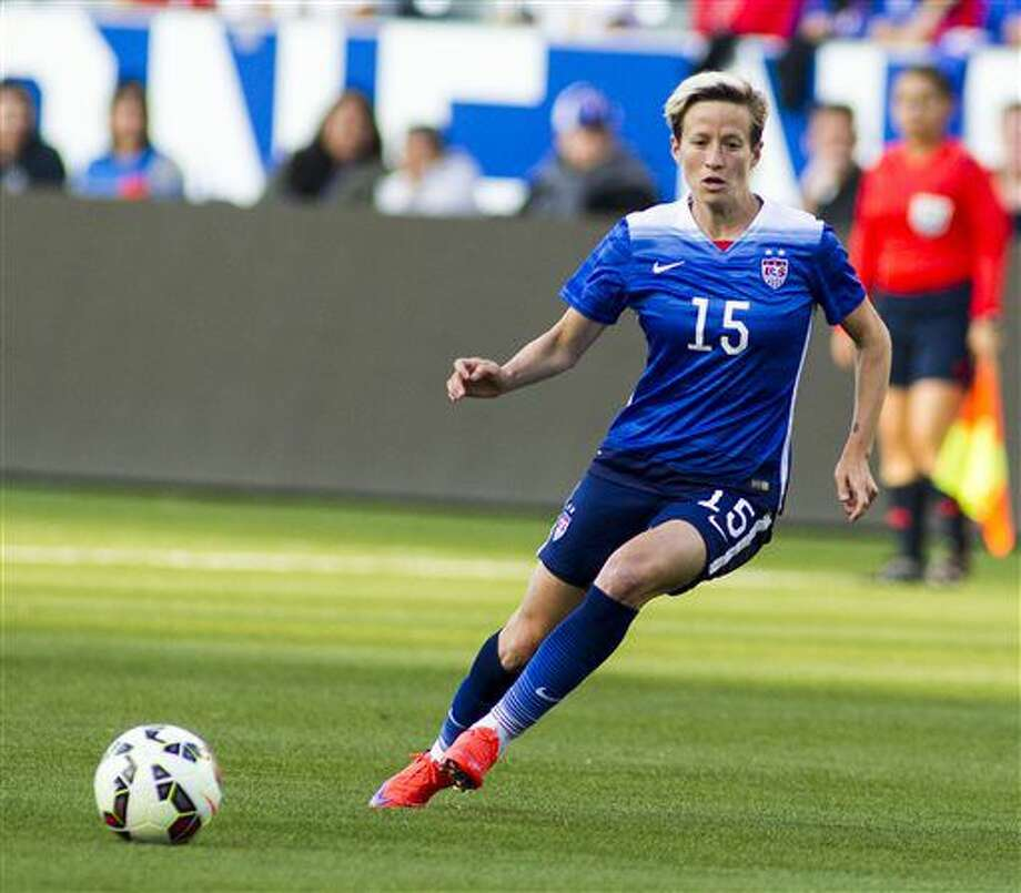 FILE - In this May 17, 2015, file photo, United States' midfielder Megan Rapinoe dribbles against Mexico during a soccer friendly match at StubHub Center? in Carson, Calif. Rapinoe, who is coming off of ACL surgery on her right knee in December, has been named to the national team roster for the Rio Olympic Games. (AP Photo/Ringo H.W. Chiu, File0 Photo: Ringo H.W. Chiu