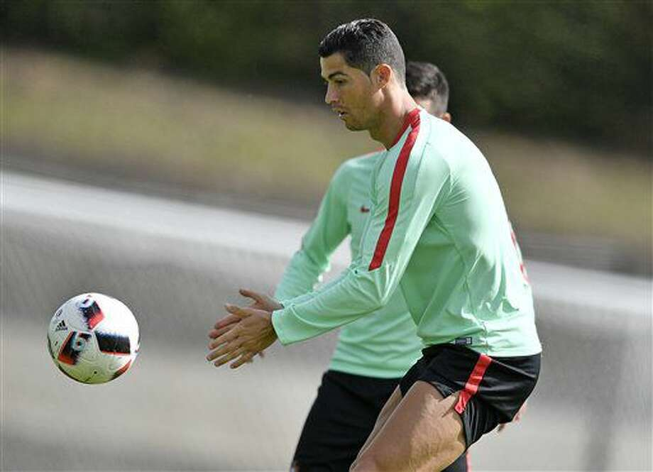 Portugal's Christiano Ronaldo exercises with the ball during a training session in Marcoussis, near Paris, France, Wednesday, June 29, 2016. Portugal will face Poland in a Euro 2016 quarter final soccer match in Marseille on Thursday, June 30, 2016. (AP Photo/Martin Meissner) Photo: Martin Meissner