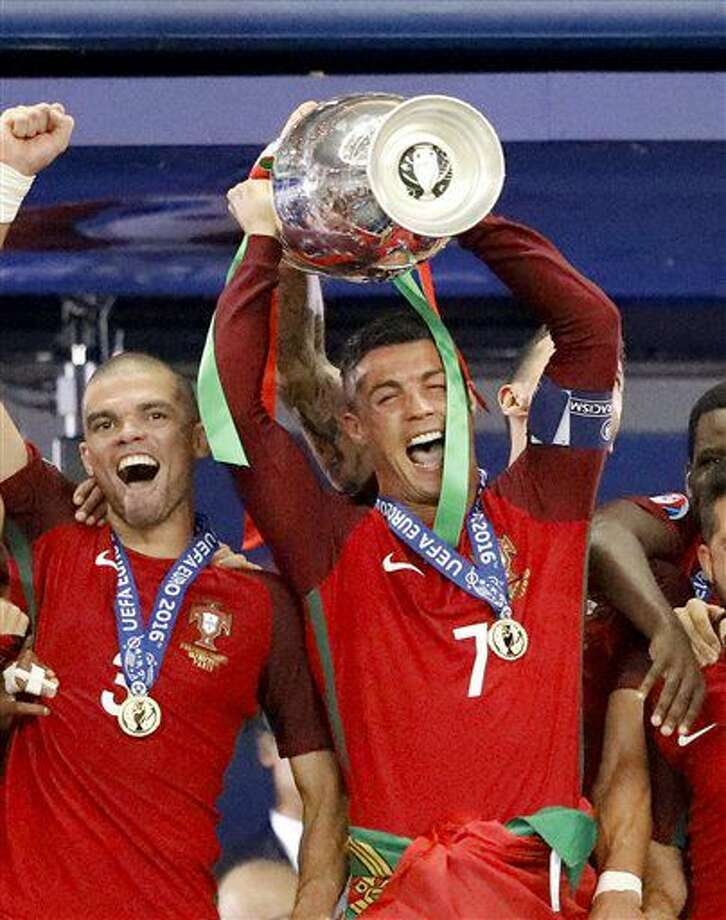 Portugal's Cristiano Ronaldo holds up the trophy at the end of during the Euro 2016 final soccer match between Portugal and France at the Stade de France in Saint-Denis, north of Paris, Sunday, July 10, 2016. Portugal won 1-0. (AP Photo/Frank Augstein) Photo: Frank Augstein