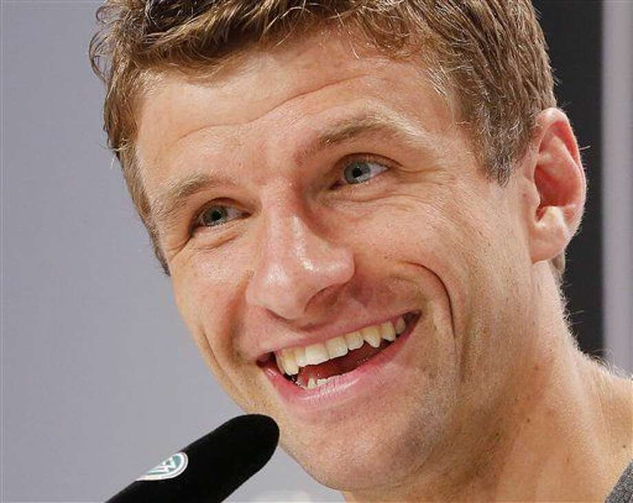 Thomas Mueller speaks during a press conference after a training session of the German national football team at their base camp in Evian-Les-Bains, France, Tuesday, July 5, 2016. Germany will face France in a Euro 2016 semifinal soccer match in Marseille on Thursday, July 7, 2016 (AP Photo/Michael Probst) Photo: Michael Probst