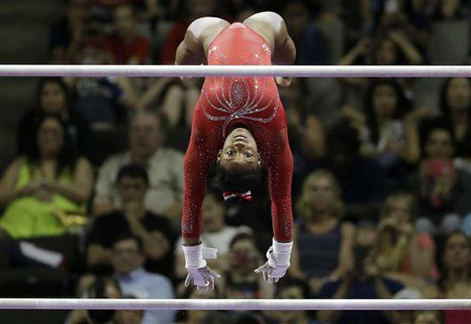 Simone Biles competes on the uneven bars during the women's U.S. Olympic gymnastics trials in San Jose, Calif., Sunday, July 10, 2016. (AP Photo/Gregory Bull) Photo: Gregory Bull