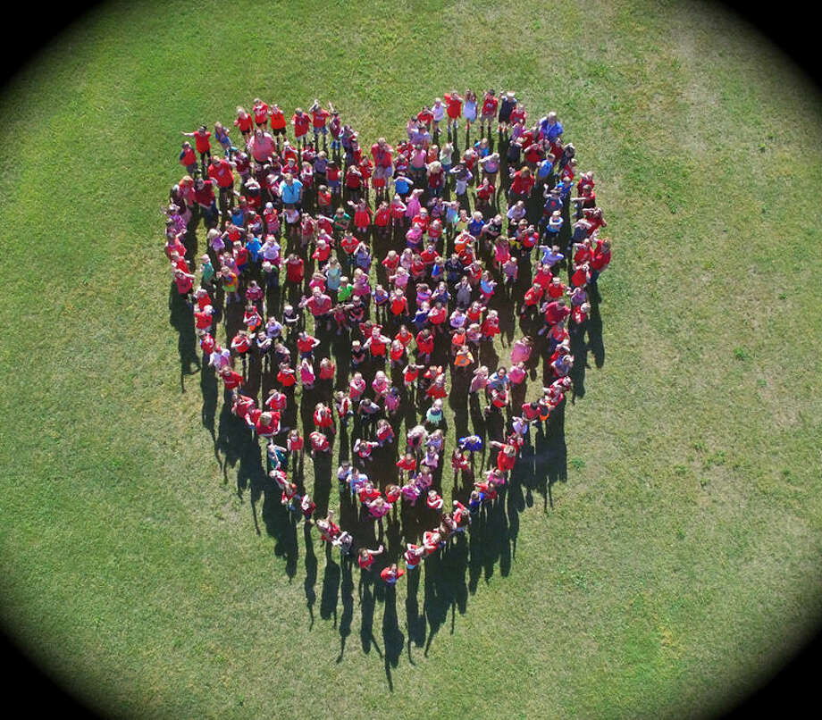 Bullock Creek Elementary School students are shown forming a heart celebrating a successful Jump Rope fpor Heart program this year. Photo: Photo Provided