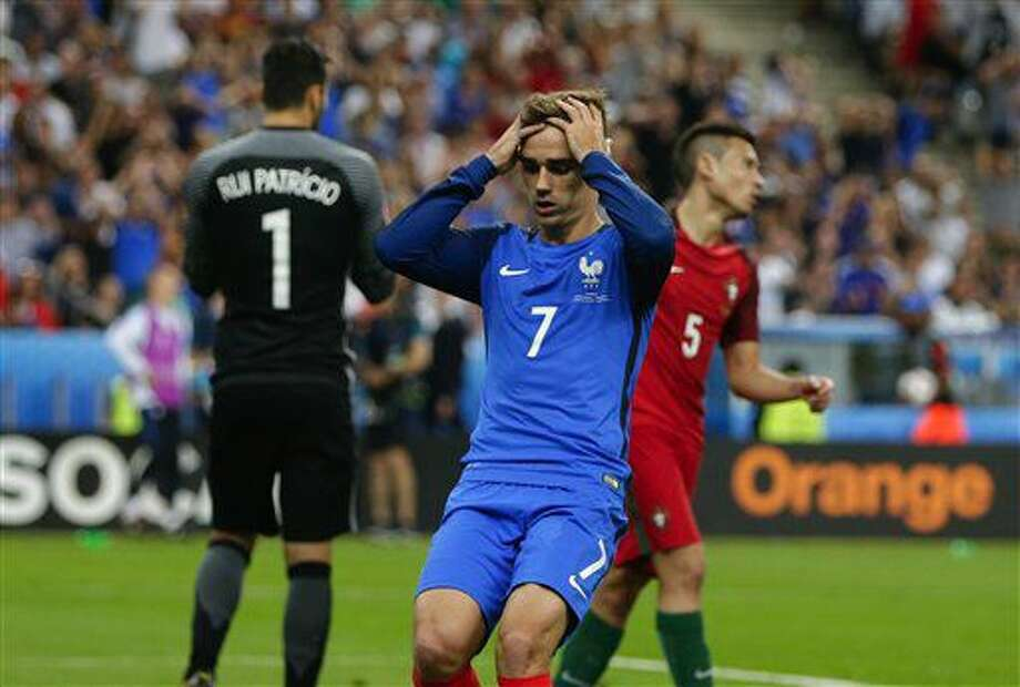 France's Antoine Griezmann reacts after missing an opportunity to score during the Euro 2016 final soccer match between Portugal and France at the Stade de France in Saint-Denis, north of Paris, Sunday, July 10, 2016. (AP Photo/Thanassis Stavrakis) Photo: Thanassis Stavrakis