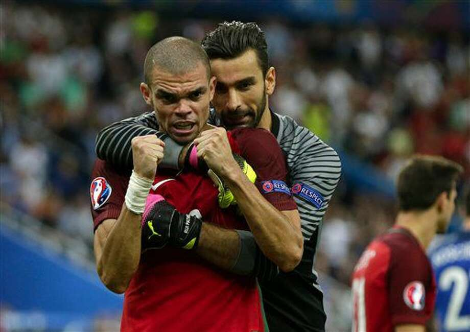 Portugal goalkeeper Rui Patricio, right, celebrates with Pepe winning the Euro 2016 final soccer match between Portugal and France at the Stade de France in Saint-Denis, north of Paris, Sunday, July 10, 2016. (AP Photo/Thanassis Stavrakis) Photo: Thanassis Stavrakis
