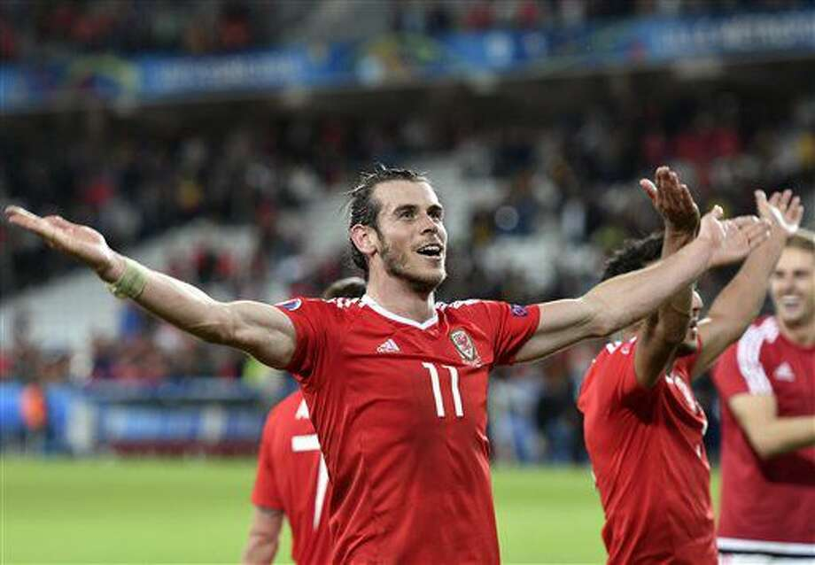 Wales' Gareth Bale celebrates at the end of the Euro 2016 quarterfinal soccer match between Wales and Belgium, at the Pierre Mauroy stadium in Villeneuve d'Ascq, near Lille, France, Friday, July 1, 2016. Wales won 3-1. (AP Photo/Martin Meissner) Photo: Martin Meissner