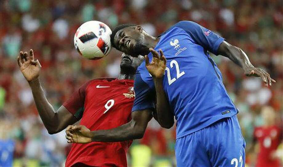Portugal's Eder, left, and France's Samuel Umtiti vie for the ball during the Euro 2016 final soccer match between Portugal and France at the Stade de France in Saint-Denis, north of Paris, Sunday, July 10, 2016. (AP Photo/Frank Augstein) Photo: Frank Augstein