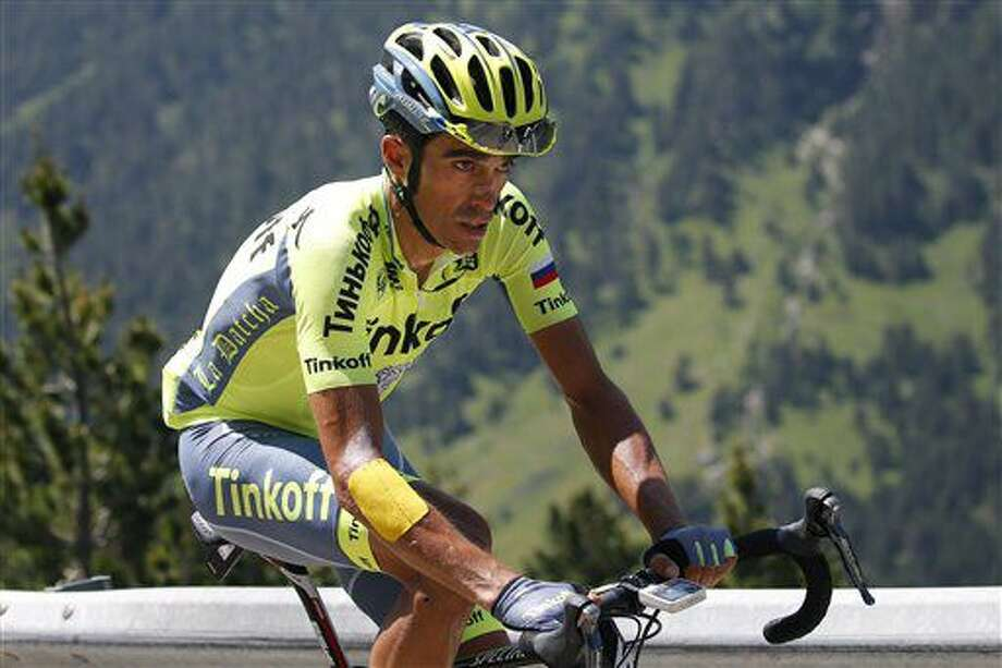 Spain's Alberto Contador strains as he rides at the back of the pack during the ninth stage of the Tour de France cycling race over 184.5 kilometers (114.3 miles) with start in Vielha Val d'Aran, Spain, and finish in Andorra Arcalis, Andorra, Sunday, July 10, 2016. Contador abandoned halfway through the stage with a fever. (AP Photo/Christophe Ena) Photo: Christophe Ena