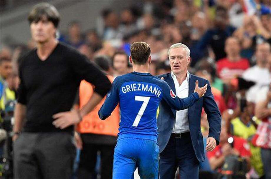 France coach Didier Deschamps shakes hands with France's Antoine Griezmann after he was substituted during the Euro 2016 semifinal soccer match between Germany and France, at the Velodrome stadium in Marseille, France, Thursday, July 7, 2016. In the foreground is Germany coach Joachim Loew. (AP Photo/Martin Meissner) Photo: Martin Meissner