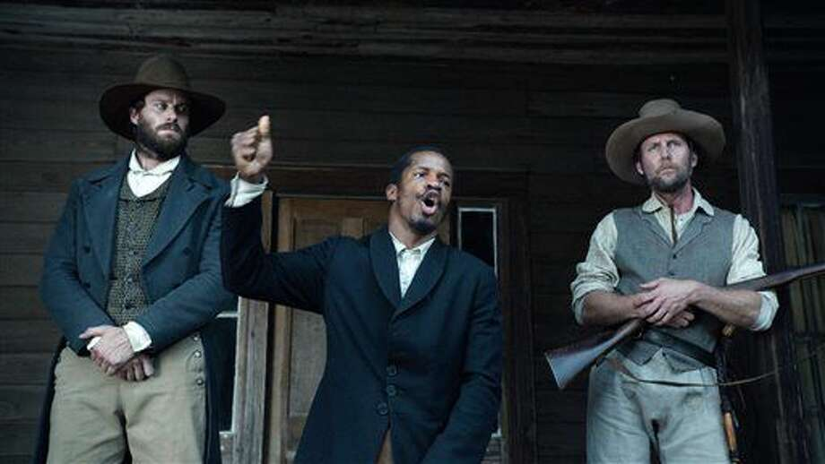 "In this image released by Fox Searchlight Pictures, from left, Armie Hammer portrays Samuel Turner, Nate Parker portrays Nat Turner and Jayson Warner Smith portrays Earl Fowler in a scene from ""The Birth of a Nation,"" opening Oct. 7, 2016. Parker said he hopes the movie will inspire people to challenge injustices worldwide and said the lecture series would help. (Fox Searchlight Pictures via AP) Photo: HONS"