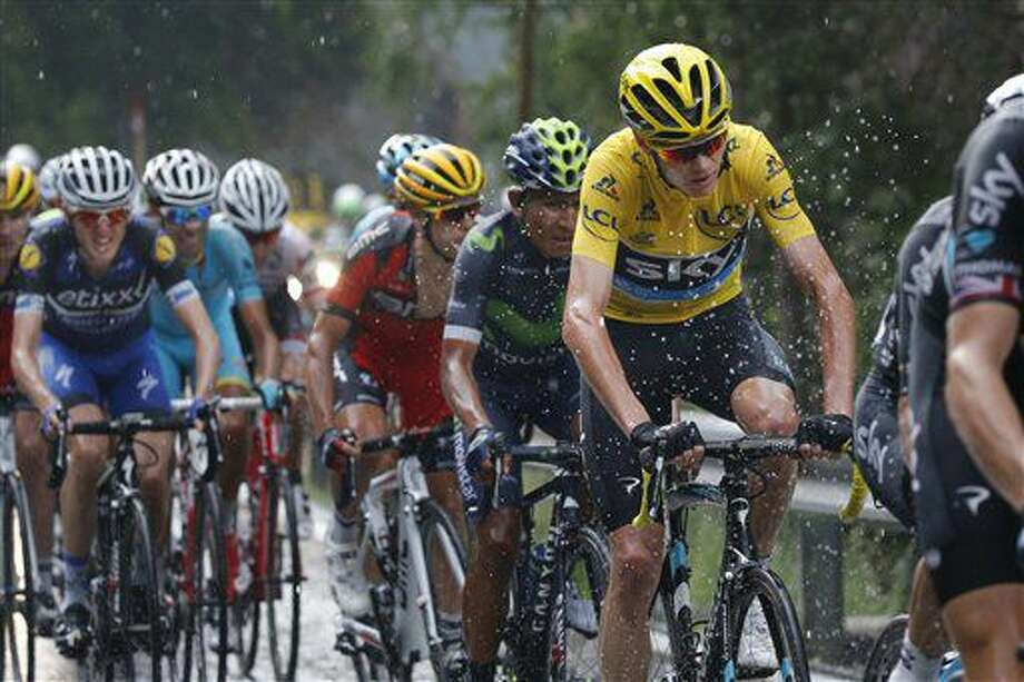 Britain's Chris Froome, wearing the overall leader's yellow jersey, Colombia's Nairo Quintana, Australia's Richie Porte, Italy's Vincenzo Nibali, and Ireland's Daniel Martin, from left to right, ride in the rain during the ninth stage of the Tour de France cycling race over 184.5 kilometers (114.3 miles) with start in Vielha Val d'Aran, Spain, and finish in Andorra Arcalis, Andorra, Sunday, July 10, 2016. (AP Photo/Christophe Ena) Photo: Christophe Ena