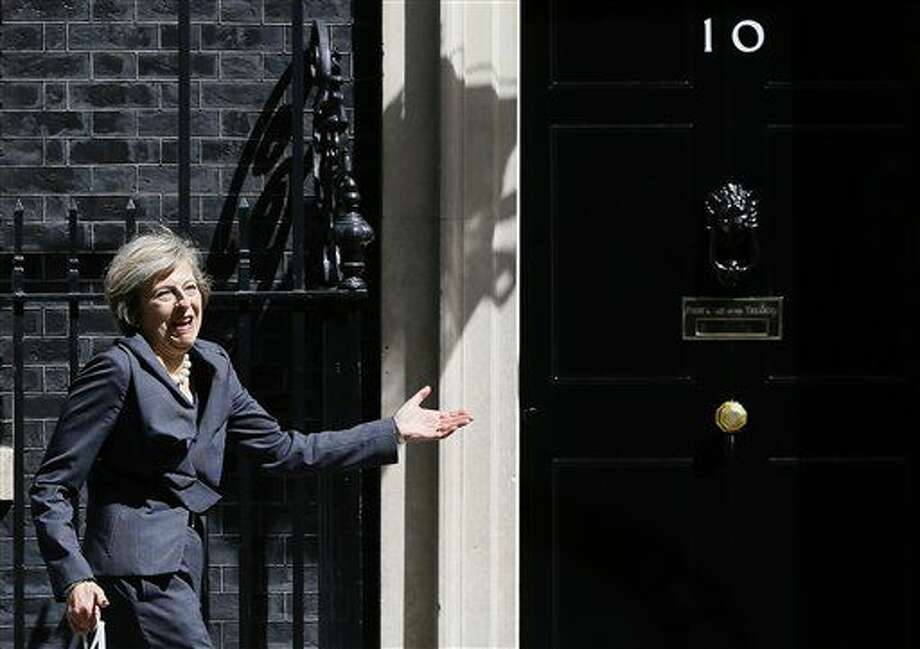 Britain's Home Secretary Theresa May gestures as she leaves after attending a cabinet meeting at 10 Downing Street, in London, Tuesday, July 12, 2016. Theresa May will become Britain's new Prime Minister on Wednesday. (AP Photo/Kirsty Wigglesworth) Photo: Kirsty Wigglesworth