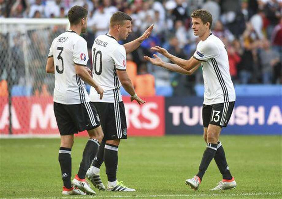 Germany's Jonas Hector, Lukas Podolski and Thomas Mueller, from left to right, celebrate at the end of the Euro 2016 round of 16 soccer match between Germany and Slovakia, at the Pierre Mauroy stadium in Villeneuve d'Ascq, near Lille, France, Sunday, June 26, 2016. (AP Photo/Geert Vanden Wijngaert) Photo: Geert Vanden Wijngaert