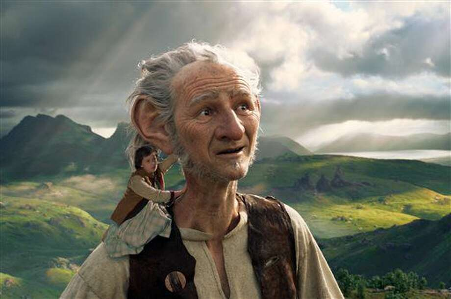 """FILE - This image released by Disney shows Ruby Barnhill and the Big Friendly Giant from Giant Country, voiced by Mark Rylance, in a scene from""""The BFG."""" """"The Legend of Tarzan"""" and """"The BFG"""" were both dwarfed by """"Finding Dory"""" over the July 4th weekend, as the Pixar sequel led the box office for the third straight weekend. (Disney via AP, File) Photo: Uncredited"""