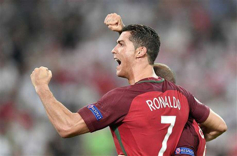 Portugal's Cristiano Ronaldo celebrates after winning the Euro 2016 quarterfinal soccer match between Poland and Portugal, at the Velodrome stadium in Marseille, France, Thursday, June 30, 2016. (AP Photo/Martin Meissner) Photo: Martin Meissner