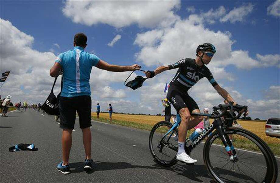 Britain's Chris Froom grabs a bag with food from a team member in the feeding zone during the fourth stage of the Tour de France cycling race over 237.5 kilometers (147.3 miles) with start in Saumur and finish in Limoges, France, Tuesday, July 5, 2016. (AP Photo/Peter Dejong) Photo: Peter Dejong