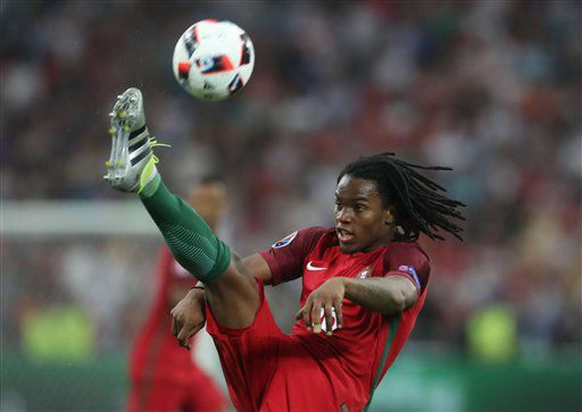Portugal's Renato Sanches hit a ball during the Euro 2016 quarterfinal soccer match between Poland and Portugal, at the Velodrome stadium in Marseille, France, Thursday, June 30, 2016. (AP Photo/Petr David Josek)