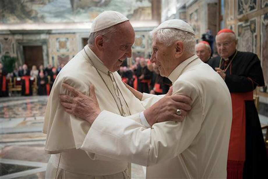 Pope Francis, left, and retired Pope Benedict XVI embrace during a ceremony to celebrate Benedict's 65th anniversary of his ordination as a priest, in the Clementine Hall of the Apostolic Palace, at the Vatican, Tuesday, June 28, 2016. The ceremony served in part to show continuity from Benedict to Francis amid continued nostalgia from some conservatives for Benedict's tradition-minded papacy. (L'Osservatore Romano/Pool photo via AP) Photo: Uncredited