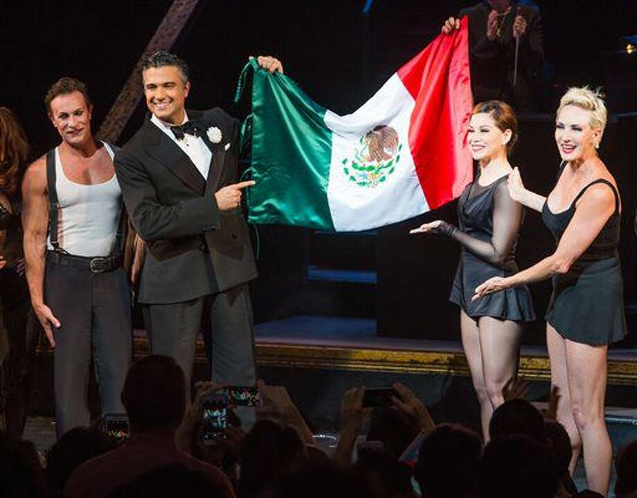 "In this July 11, 2016 image released by Boneau/Bryan-Brown, from left, R. Lowe, Jaime Camil, Bianca Marroquin and Amra Faye Wright appear at the curtain call for the musical ""Chicago,"" in New York. Camil and Marroquin, both actors from Mexico, are holding the Mexican flag. (Jeremy Daniel/Boneau/Bryan-Brown via AP) Photo: Jeremy Daniel"