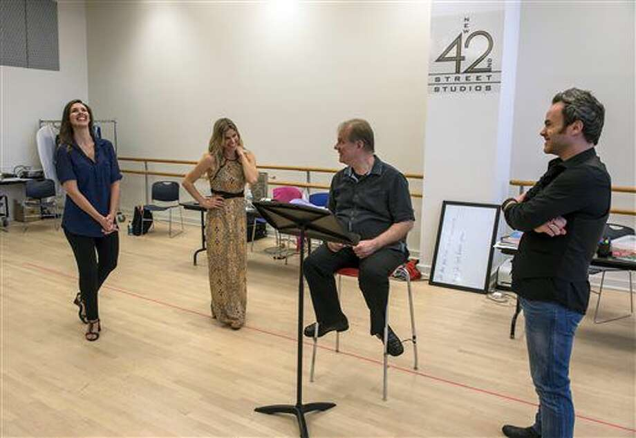 In this July 7, 2016 image released by Gabe Palacio Photography, conductor Will Crutchfield, seated, appears with tenor Andrew Owens, right, mezzo-soprano Tamara Mumford, left, and soprano Georgia Jarman during rehearsals for Aureliano in Palmira by Gioachino Rossini in New York (Gabe Palacio via AP) Photo: Gabe Palacio