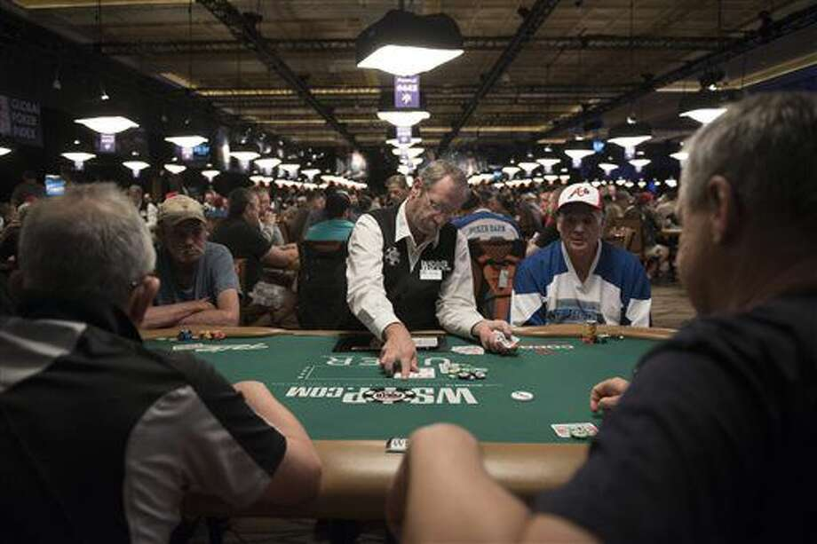 In this photo taken Saturday, July 9, 2016, Ray Knee, center, deals during Day 1A of the Main Event of the World Series of Poker at the Rio Convention Center in Las Vegas. (Jason Ogulnik/Las Vegas Review-Journal via AP) Photo: Jason Ogulnik