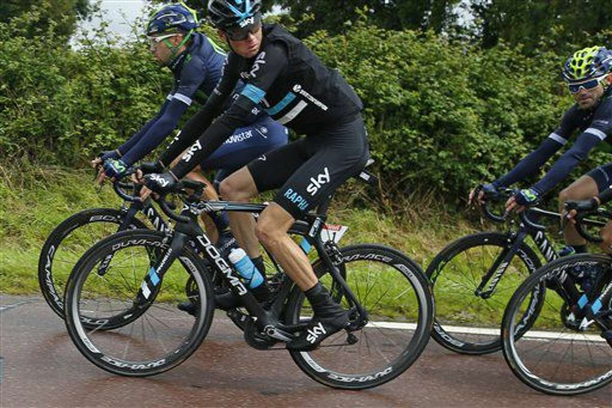 Britain's Chris Froome looks back as he rides in the pack during the second stage of the Tour de France cycling race over 183 kilometers (113.7 miles) with start in Saint-Lo and finish in Cherbourg-en-Cotentin, France, Sunday, July 3, 2016. (AP Photo/Peter Dejong)
