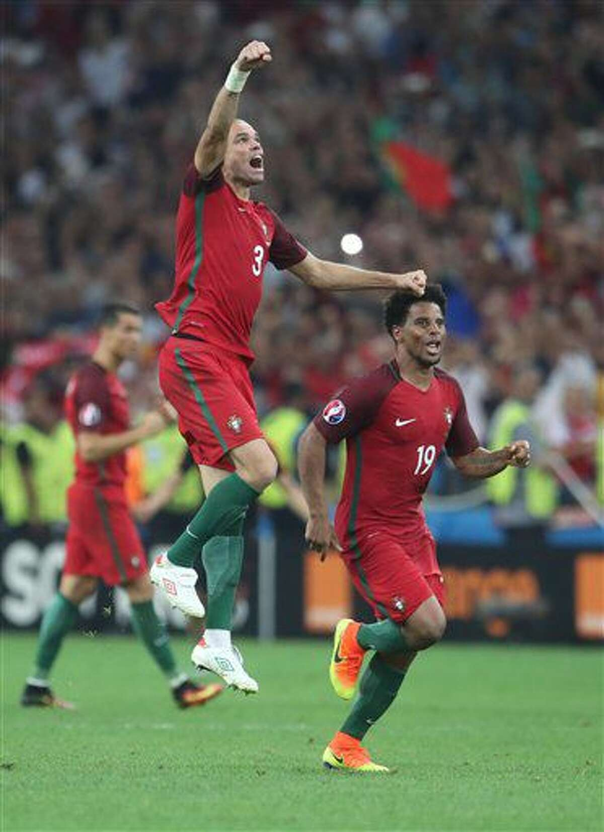 Portugal's Pepe, left, celebrates with Portugal's Eliseu winning the Euro 2016 quarterfinal soccer match between Poland and Portugal, at the Velodrome stadium in Marseille, France, Thursday, June 30, 2016. (AP Photo/Petr David Josek)