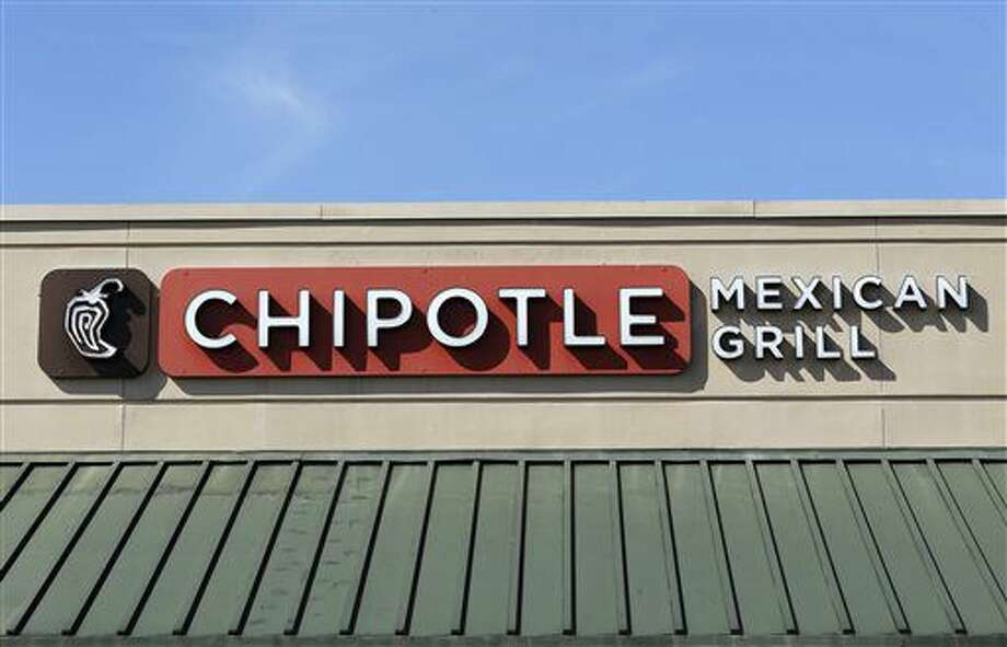 This Monday, Feb. 8, 2016, photo shows the sign over a Chipotle Mexican Grill in Brandon, Fla. The Chipotle marketing executive leading the chain's efforts to rebound after an E. coli outbreak was arrested Tuesday, July 5, 2016, on multiple counts of cocaine possession. (AP Photo/Chris O'Meara) Photo: Chris O'Meara
