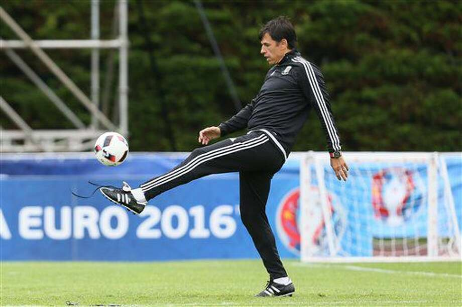 Wales' coach Chris Coleman juggles with the ball prior to a training session in Dinard, western France, Tuesday, July 5, 2016. Wales will face Portugal in a Euro 2016 semifinal match at the Grand Stade in Decines-Charpieu, near Lyon, France, Wednesday, July 6, 2016. (AP Photo/David Vincent) Photo: David Vincent