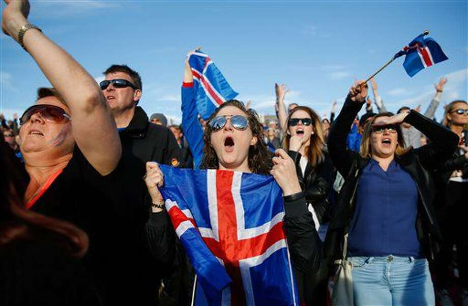 Iceland soccer fans watch the Euro 2016 quarterfinal match between Iceland and France on a large screen in Reykjavik, Iceland, Sunday July 3, 2016. (AP Photo/Brynjar Gunnarsson) Photo: Brynjar Gunnarsson